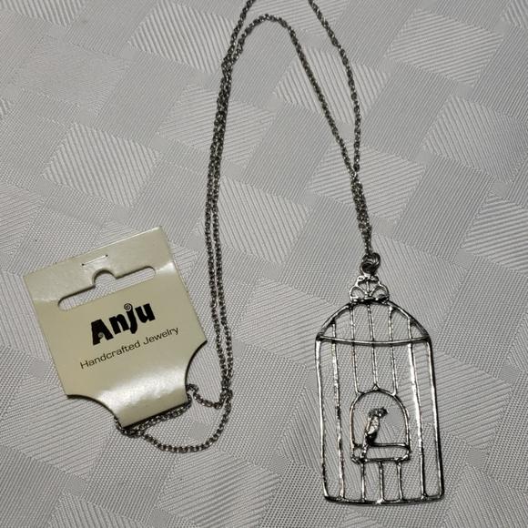 ANJU  Bird In A Cage Silver tone Necklace NWT